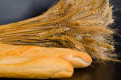 White loaves and a sheaf on a dark background. Close-up stock photo