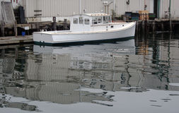 White lobster boat in harbor Stock Images