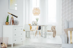 White loft interior with dresser. Table and chairs Royalty Free Stock Photography