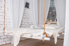 White loft interior with Hanging bed suspended from the ceiling. Modern design Royalty Free Stock Photos