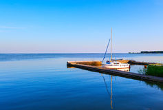 White lone sailboat docked at the pier. Lithuania Stock Photography
