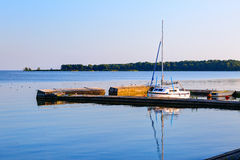 White lone sailboat docked at the pier. Lithuania Stock Images