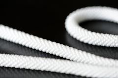 White long beaded necklace on a dark background. Close up stock images