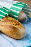 White long bread. In paper bag Royalty Free Stock Photo
