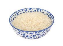 White long grain rice in a blue and white china bowl Stock Image