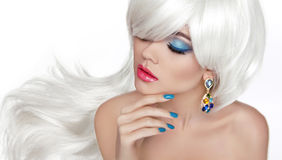 White Long hair. Eye makeup. Beautiful blond with fashion jewelry Royalty Free Stock Image