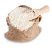 White long rice in small burlap sack with wooden scoop Royalty Free Stock Photos