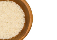 White long rice on the white background, uncooked raw cereals closeup Royalty Free Stock Photos