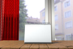 White loose-leaf calendar mock up in front of blurred background. 3d illustration of empty desk calendar. White loose-leaf calendar mock up in front of blurred Stock Photos