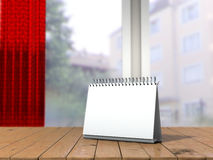White loose-leaf calendar mock up in front of blurred background. 3d illustration of empty desk calendar. White loose-leaf calendar mock up in front of blurred Royalty Free Stock Photos
