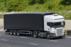 White lorry black trailer Stock Photography