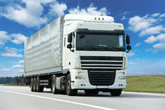 White lorry with grey trailer over blue sky Royalty Free Stock Photography