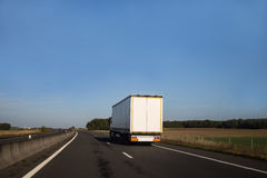 White lorry on an open road Royalty Free Stock Image