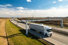 White lorry passing toll gate on Prague Circuit, Czech republic. Big white lorry passing toll gate on Prague Circuit, Czech republic Royalty Free Stock Photography