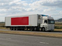 White lorry with red banner Stock Photography