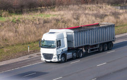 White lorry with trailer in motion on the motorway Royalty Free Stock Photo