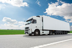 White lorry with trailer over blue sky. Single white lorry truck with trailer over blue sky on the road royalty free stock photo