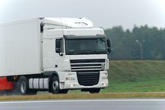 White lorry on wet road Royalty Free Stock Photos