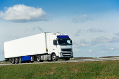 White lorry with white trailer over blue sky Stock Photos