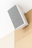 White loudspeaker. Is hanging on the wall of shopping mall royalty free stock image