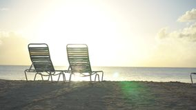 Two lounge chairs on beautiful tropical beach at Maldives. White lounge chairs on beautiful tropical beach stock footage