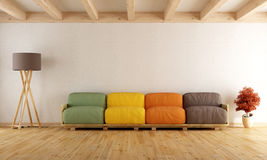 White lounge with colorful pallet sofa Royalty Free Stock Photography