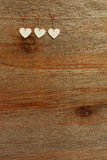 White Love Valentine's hearts hanging on wooden texture backgrou Royalty Free Stock Image