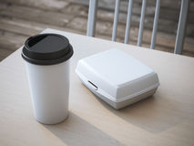 White lunch box with paper cup of coffee. 3d rendering. White lunch box with blank paper cup of coffee. 3d rendering Stock Photography
