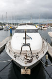 White luxurious private motor yacht at port in Galicia Royalty Free Stock Photos