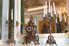 Wedding hall with a classic fireplace with stucco, large beautiful chandelier and painted ceilings, vase stock images