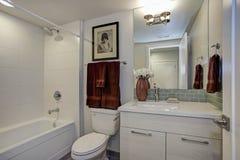 New luxury bathroom in pure white tones. White luxury bathroom with bathroom cabinet and shower stock photos