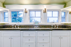 White luxury bathroom cabinet with two sinks. White luxury bathroom cabinet with two sinksand three windows Stock Images