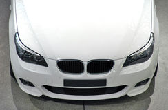 White luxury car. Front/top view Royalty Free Stock Photo
