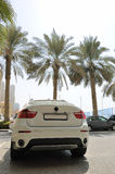 White luxury car parked near hotel. Dubai, United Arab Emirates Royalty Free Stock Image