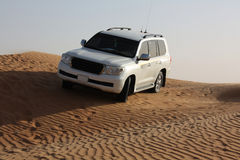 White luxury car is in the sand. White jeep is in the desert Royalty Free Stock Images