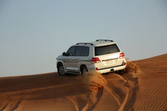 White luxury car is in the sand. White jeep is in the desert Stock Image