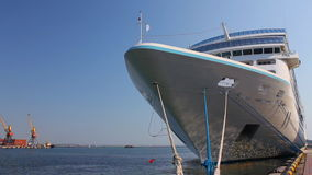 A white luxury cruise liner docked in the port Stock Photography