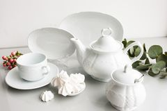White luxury expensive porcelain tea set. Expensive porcelain tea set on white background. Proper quality dishes concept royalty free stock photography