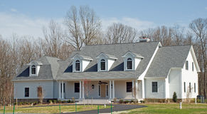 White Luxury Home 25. Two story luxury home with white siding and an asphalt circular driveway Royalty Free Stock Photo
