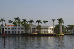 White Luxury house. Along Canal. Surrouned by Palm trees Royalty Free Stock Image