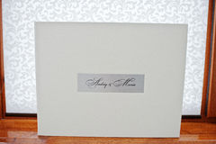 White luxury leather wedding book. In box stock images