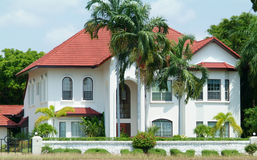 White luxury villa. In tropical climate surounded by palm trees Stock Photography