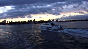 White luxury yacht cruising to Miami USA cityscapes stock video footage
