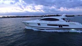 White luxury yacht cruising to Miami USA cityscapes stock footage