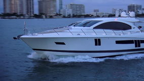 White luxury yacht on water USA cityscapes stock video
