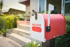 White Mail Box in Front of a House Royalty Free Stock Image