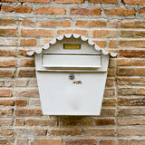 White Mail Box in Front of wall Royalty Free Stock Photo