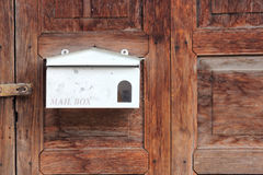 White mail box on old wooden door Stock Image