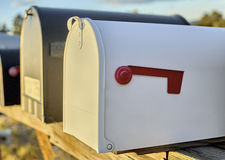 White Mailbox with Red Flag Down Royalty Free Stock Image