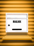 White Mailbox on yellow shelf Royalty Free Stock Images